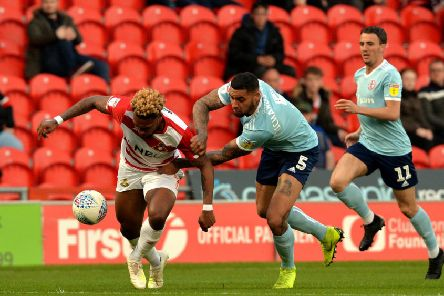 NEW FACE: Ben Richards-Everton battles with Doncaster Rovers' Mallik Wilks at the Keepmoat Stadium. 'Picture: Bruce Rollinson