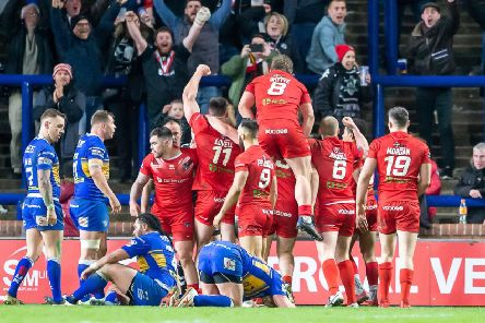 KILLER BLOW: London Broncos' players celebrate Will Lovell's try to seal the victory against Leeds Rhinos at Headingley back in March. Picture: Allan McKenzie/SWpix.com