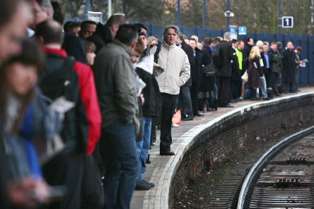 Commuters waiting on the platform.