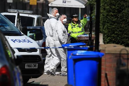 Forensics officers at the scene. Picture: Danny Lawson/PA Wire