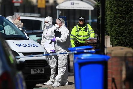 Forensics officers at a property. Picture: Danny Lawson/PA Wire