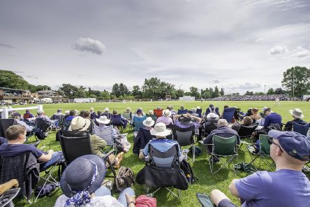 Supporters watch on as Yorkshire play Warwickshire at York's Clifton Park Cricket Club.