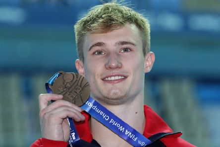 Britain's Jack Laugher holds up the bronze medal he won in the men's 3m springboard diving final at the World Swimming Championships in Gwangju, South Korea today.