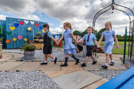 Stanley Metcalf's twin sister Elsie leads her brother's friend through a special peace garden that has opened in his memory at St Mary's Queen of Martyr's School in Bransholme, Hull.