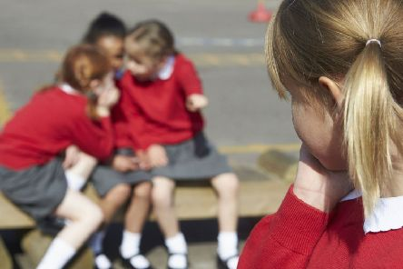What can be done to reduce the costs of school uniforms?