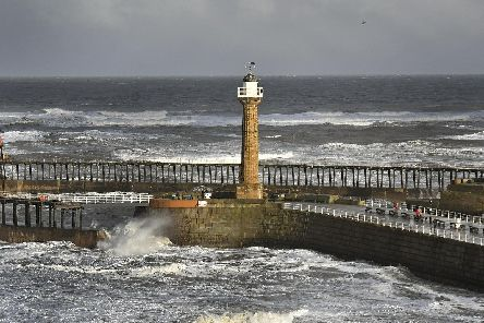 Whitby's Pier and Lighthouse take a battering in the the strong winter winds