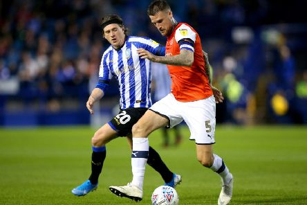 Sheffield Wednesday's Adam Reach (left) and Luton Town's Sonny Bradley battle for the ball.