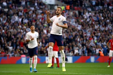 England's Harry Kane celebrates scoring his side's fourth goal of the game from the penalty spot at Wembley. Picture: Tim Goode/PA