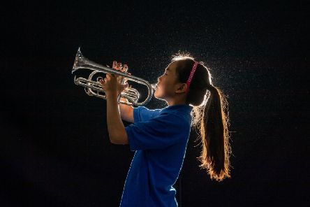 Kirkbymoorside Brass Band, one of the oldest in the country, have just moved into their new hall named the James Holt Concert Hall. Pictured Band member Yanxi Wang, aged 10, from Kirkbymoorside, playing her cornet during the rehearsal. Image: James Hardisty