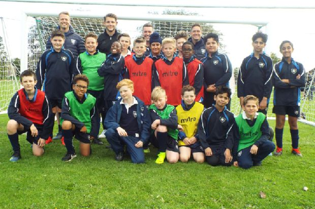 Pudsey pupils get coaching from former Huddersfield Town football player