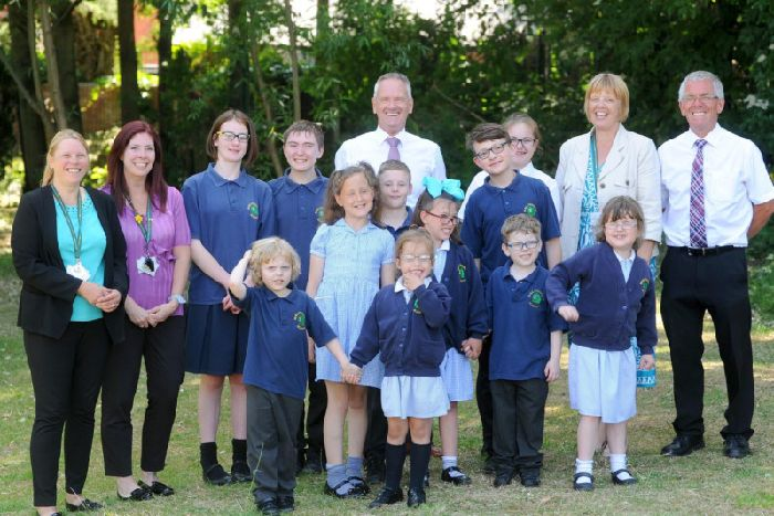 Staff and pupils at Park School celebrate after being rated outstanding again by Ofsted. Senior leadership team, Vicky Heaney, Annie Millard, Keith Berry, Gill Hughes and Stuart Bradford with some of the pupils