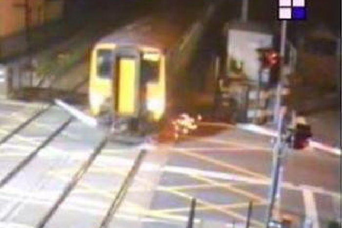 8a1c2f1785 CCTV footage shows sparks flying through the air as the train smashed into  the stricken barrier