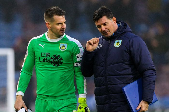 16c72e30134c5c Burnley s Tom Heaton chats with goalkeeping coach Billy Mercer after the  first half  Photographer