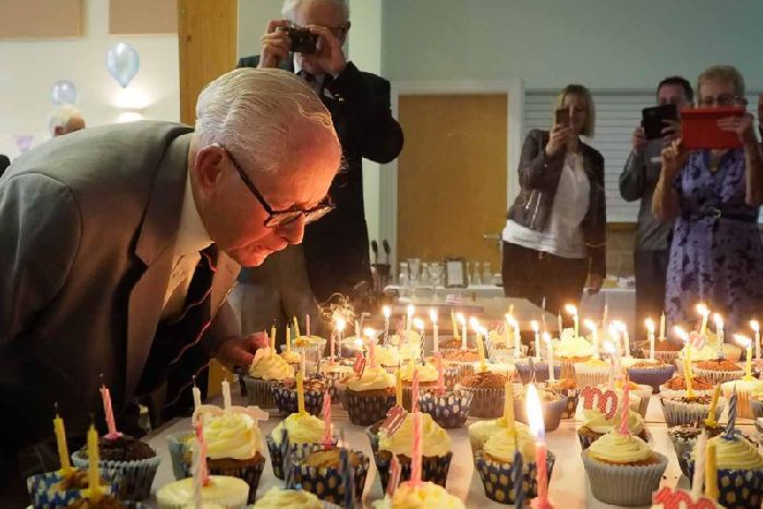 John Shannon Blows Out His 100 Birthday Cake Candles