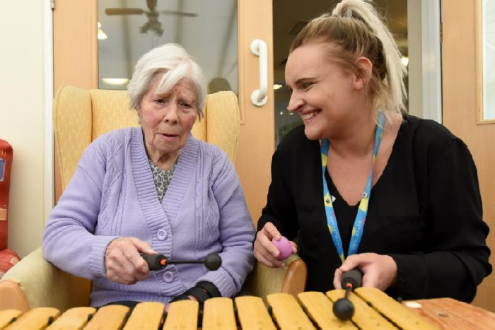 Jessica McGinty with Abby Waylett from Age Concern Central Lancashire at the Charney Fold centre at a a Life Long Song session