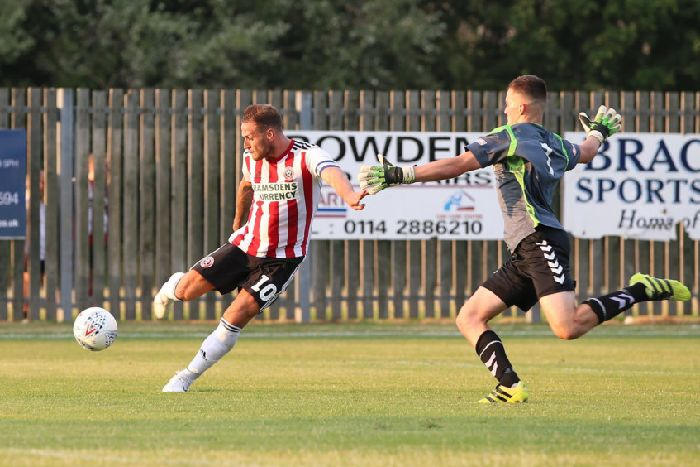 daf25221487 Billy Sharp slams in one of his two goals in the Blades  friendly win at