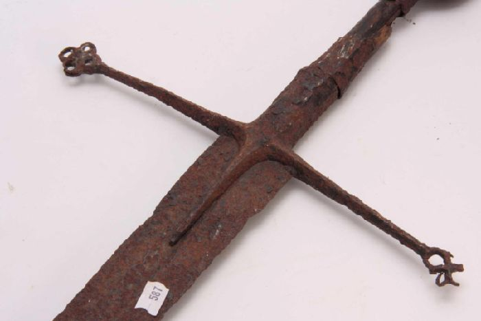 Highlander sword sold at auction at Hutchinson Scott, at Skipton, for 30,000. The sword is believed to date from the 15th or 16th Century and was originally valued at 200. Picture: SWNS