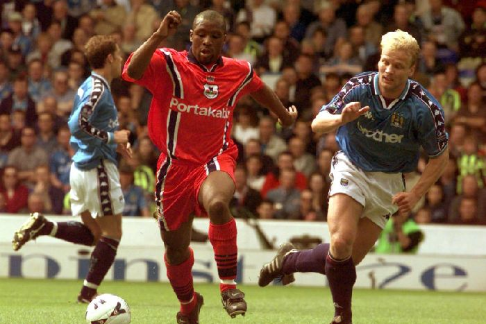 d12c78f2 On the attack: York's Rodney Rowe goes past the Manchester City defence.