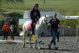 A covered equestrian arena at Buxton Riding School would enable riders them to ride more often throughout the year.