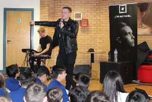 Joel Rothwell performing at QEGS