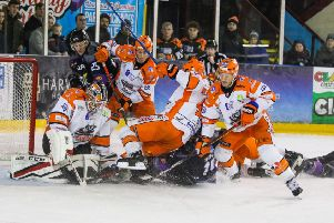 Jonathan Phillips battles for possession in front of the Sheffield Steelers' net in Manchester. Picture: Mark Ferriss/EIHL.