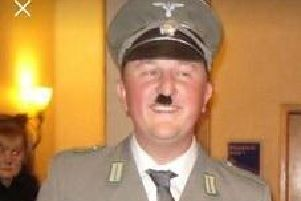 Coun Seve Gomez-Aspron dressed at Hitler at the fundraiser