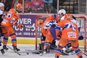 Anthony DeLuce drives the net in vain, against Clan