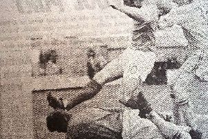 Shrewsbury keeper Ken Mulhearn gathers the ball under pressure from Pools player Kevin McMahon.