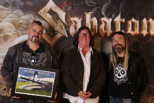 Heugh Battery Museum manager Diane Stephens with members of band  Sabaton who raised over �4,000 for the museum.