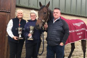 Emma Armstrong (left) and David Armstrong (right) with Mabs Cross at Highfield Farm in Chorley