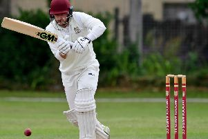 Greg Finn in action forWoodlands during Sunday's comfortable Priestley Cup semi-final victory over Hanging Heaton at Albert Terrace as the Bradford Premier League leaders maintained their double hopes. Picture: Paul Butterfield