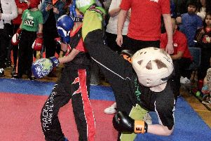 George Emsley lands a head kick in one of his kickboxing contests at the National Championships.