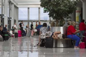 Stranded holiday-makers wait for news after the collapse of Thomas Cook.