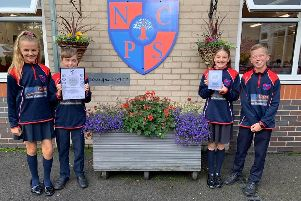 Newfold pupils proudly display their certificate