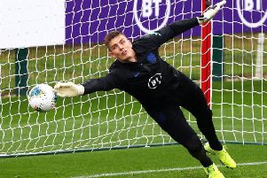 Burnley goalkeeper Nick Pope at full stretch during an England camp at St George's Park