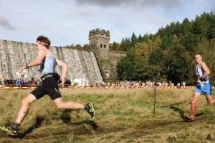 Harry Holmes leads the charge from Stuart Bond for Matlock AC at the British Fell Running Championships.