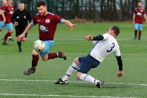 Littletown's James Blane skips past Matthew Agar of Morley Town during his side's 9-0 win in the Terry Marflitt Cup.
