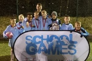 The St Mary's Primary School Under 11s team is pictured with Leeds United player Jamie Shackleton.