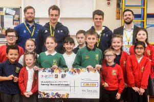 Aldi Cheque: Alistair and Jonny Brownlee at East Brierley School.
