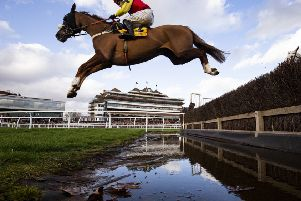 Native River clears the water jump at Newbury under Jonjo O'Neill junior.
