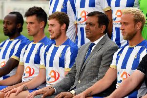 Hartlepool United chairman Raj Singh sits in for the official Hartlepool United team photo.  Picture by Frank Reid