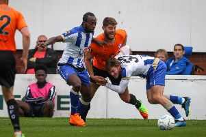 Hartlepool United's Niko Muir and Luke James.