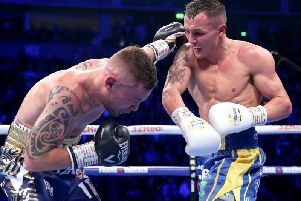 Josh Warrington lands a heavy blow on Carl Frampton during the pair's IBF featherweight clash in Manchester on Saturday.
