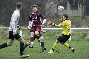 Littletown's Joe Jagger clips the ball past Fox & Hounds goalkeeper Lewis Sykes to score one of his two goals in his side's Wheatley Cup quarter-final victory last Saturday. Picture: Allan McKenzie