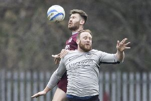 Littletown's Adam Jordan challenges for a header with Fox & Hounds' Craig Bentley during last Saturday's Heavy Woollen District FA Wheatley Cup quarter-final at Beck Lane.