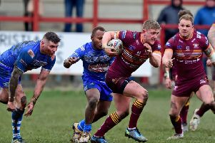 Jack Downs breaks away from the Barrow defence as he looks to set up a Bulldogs attack.