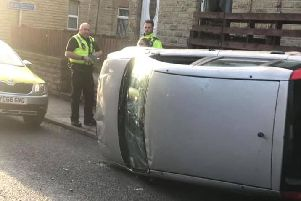 A car has been overturned on Union Road in Heckmondwike. Credit: Nathan Hardcastle