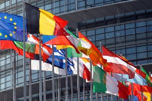 Flags flying at the European Parliament building in Strasbourg