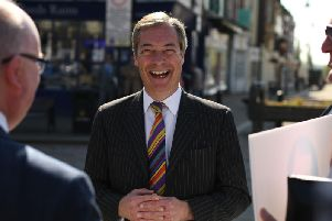Brexit Party leader Nigel Farage speaks to members of the public during a 'walkabout' campaigning for the European Parliament election in Pontefract in May.