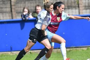 Danielle Cooper holds up a Derby attack
